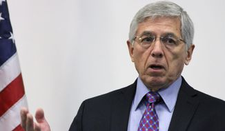 """FILE - In this Sept. 21, 2015 file photo, Alaska Lt. Gov. Byron Mallott addresses a news conference in Anchorage, Alaska. The governor of Alaska says Lt. Gov. Byron Mallott has resigned over unspecified """"inappropriate comments."""" The move upends what was already a difficult re-election fight for Gov. Bill Walker. Mallott's decision was announced Tuesday, Oct. 16, 2018, shortly after Walker participated in a debate in Anchorage. (AP Photo/Mark Thiessen, File)"""