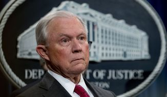 Attorney General Jeff Sessions attends a news conference to announce enforcement efforts against Cartel Jalisco Nueva Generacion, Tuesday, Oct. 16, 2018, at the Justice Department in Washington. (AP Photo/Andrew Harnik)
