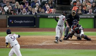 Boston Red Sox's Jackie Bradley Jr., right, watches his grand slam off Houston Astros relief pitcher Roberto Osuna during the eighth inning in Game 3 of a baseball American League Championship Series on Tuesday, Oct. 16, 2018, in Houston.(AP Photo/Lynne Sladky)