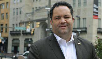 Ben Jealous, a former NAACP president who is running as the Democrat for governor of Maryland, poses for a photograph in Baltimore on Tuesday, Oct. 16, 2018, after talking to The Associated Press about his effort to unseat Republican Gov. Larry Hogan. Jealous said he would support broadening a new Maryland gun-control law to restrict firearms access to people found to be a risk to themselves or others, if elected governor.   (AP Photo/David McFadden)