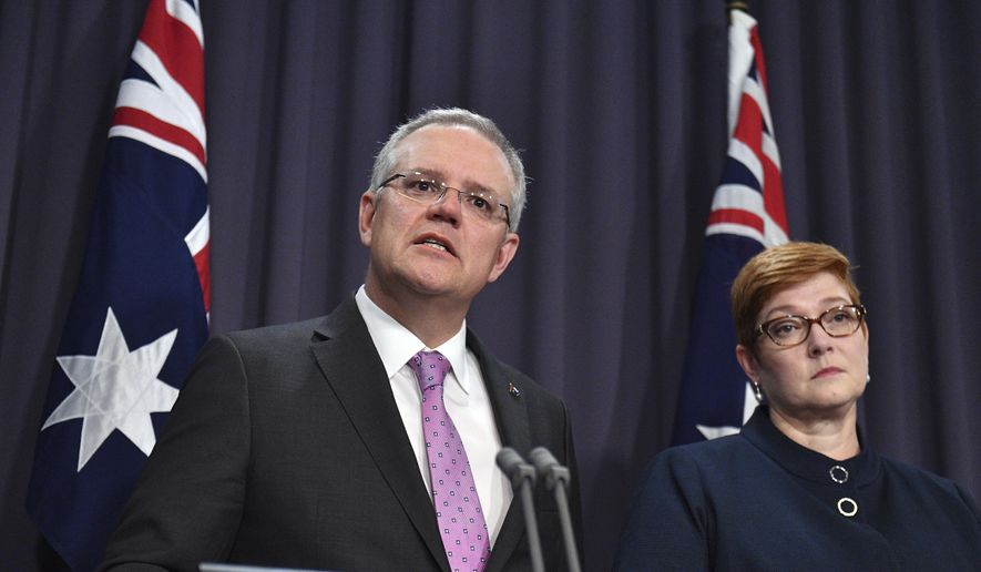 Prime Minister Scott Morrison, left, speaks to the media alongside Minister for Foreign Affairs Marise Payne during a press conference at the Parliament House in Canberra, Tuesday, October 16, 2018. Morrison said Tuesday that he was open to shifting the Australian Embassy from Tel Aviv to Jerusalem in line with President Donald Trump's decision to recognize the contested holy city as Israel's capital. (Mick Tsikas/AAP Image via AP)