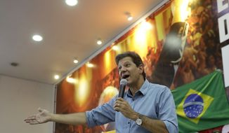 Fernando Haddad, Brazil's presidential candidate for the Workers Party, speaks during a meeting with union leaders, in Sao Paulo, Brazil, Tuesday, Oct. 16, 2018. Haddad will face Jair Bolsonaro, the far-right congressman in a presidential runoff on Oct. 28. (AP Photo/Andre Penner)