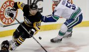 Pittsburgh Penguins' Carl Hagelin (62) chases after the puck as Vancouver Canucks' Bo Horvat pursues during the first period of an NHL hockey game, Tuesday, Oct. 16, 2018, in Pittsburgh. (AP Photo/Keith Srakocic) ** FILE **