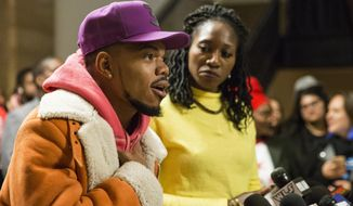 Chancelor Bennett, known professionally as Chance The Rapper, endorses Amara Enyia for mayor of Chicago during a press conference at City Hall, Tuesday morning, Oct. 16, 2018. (Ashlee Rezin/Chicago Sun-Times via AP)