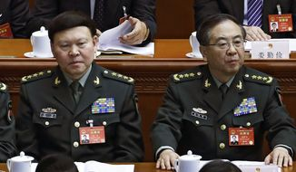 FILE - In this March 8, 2017, photo, Zhang Yang, left, the then-head of China's People's Liberation Army (PLA) political affairs department and Fang Fenghui, right, the then-chief of the general staff of the Chinese People's Liberation Army attend China's National People's Congress (NPC) at the Great Hall of the People in Beijing. China's ruling Communist Party on Tuesday, Oct 16, 2018, has expelled Zhang, a former top general who killed himself during a corruption probe and indicted another Fang, on graft charges amid a continuing crackdown on military malfeasance. (AP Photo/Andy Wong, File)