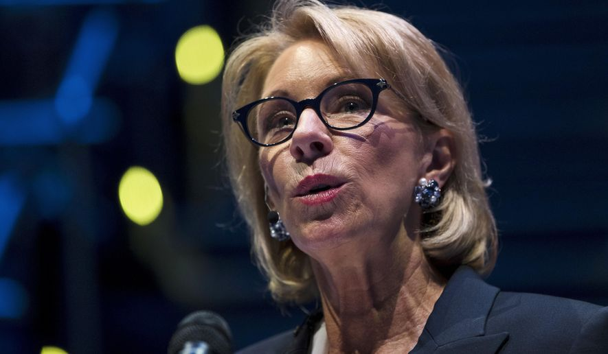 In this Sept. 17, 2018 photo, Education Secretary Betsy DeVos speaks during a student town hall at National Constitution Center in Philadelphia. A federal court has denied a request to delay an Obama-era regulation that helps students defrauded by for-profit colleges get their student loans forgiven.  (AP Photo/Matt Rourke) **FILE**