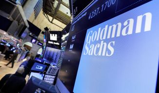 FILE - In this Dec. 13, 2016, file photo, the logo for Goldman Sachs appears above a trading post on the floor of the New York Stock Exchange. The Goldman Sachs Group Inc. reports earnings Tuesday, Oct. 16, 2018. (AP Photo/Richard Drew, File)