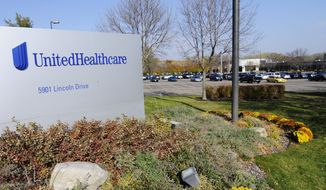 FILE - This Oct. 16, 2012, file photo, shows part of the UnitedHealth Group, Inc. campus in Minnetonka, Minn. UnitedHealth Group Inc. reports earnings Tuesday, Oct. 16, 2018. (AP Photo/Jim Mone, File)