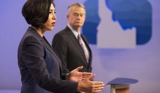 Democratic gubernatorial candidate Paulette Jordan and Lt. Gov. Brad Little participate in a debate at the studios of Idaho Public Television in Boise, Idaho, Monday, Oct. 15, 2018. (AP Photo/Otto Kitsinger)