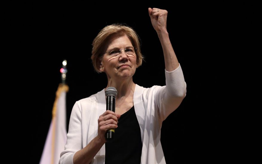 U.S. Sen. Elizabeth Warren, D-Mass., gestures during a town hall style gathering in Woburn, Massachusetts, in this Aug. 8, 2018 file photo. (AP Photo/Charles Krupa) ** FILE **