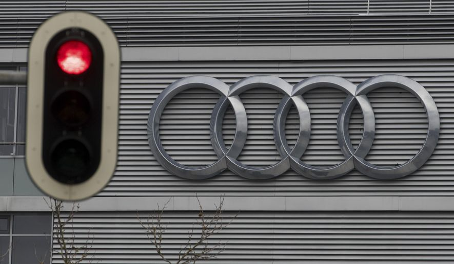FILE -- In this Wednesday, March 15, 2017 photo a traffic sign shows a red light in front of the Audi headquarters in Ingolstadt, Germany.  Audi accepted a fine of 800 million euro (927 million US$) for it's involvement in the Diesel scandal. (Armin Weigel/dpa via AP, file)