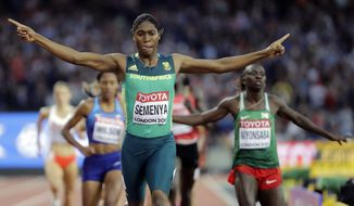FILE - In this Aug. 13, 2017, file photo, South Africa's Caster Semenya celebrates after winning the gold in the final of the Women's 800m during the World Athletics Championships in London. The governing body of track and field will not apply rules to limit natural testosterone levels in female runners until the Court of Arbitration for Sport concludes a case involving Olympic champion Caster Semenya. (AP Photo/David J. Phillip, File)