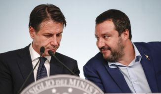 Italy's Interior Minister and Deputy-Premier Matteo Salvini, right, and Italian Premier Giuseppe Conte attend a press conference on Italy's budget law, at Chigi Palace Premier office, in Rome, Monday, Oct. 15, 2018. (Giuseppe Lami/ANSA via AP)