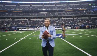 UFC fighter Conor McGregor reacts on the sideline before an NFL football game between the Dallas Cowboys and the Jacksonville Jaguars in Arlington, Texas, Sunday, Oct. 14, 2018. (AP Photo/Jim Cowsert)