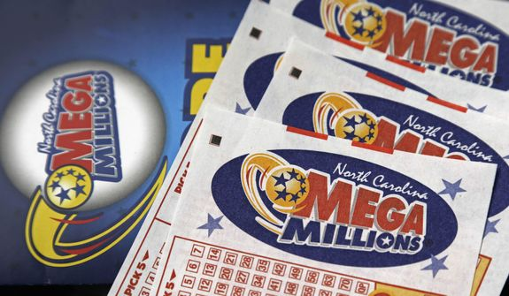 This July 1, 2016, file photo shows Mega Millions lottery tickets on a counter at a Pilot travel center near Burlington, N.C. (AP Photo/Gerry Broome, File)