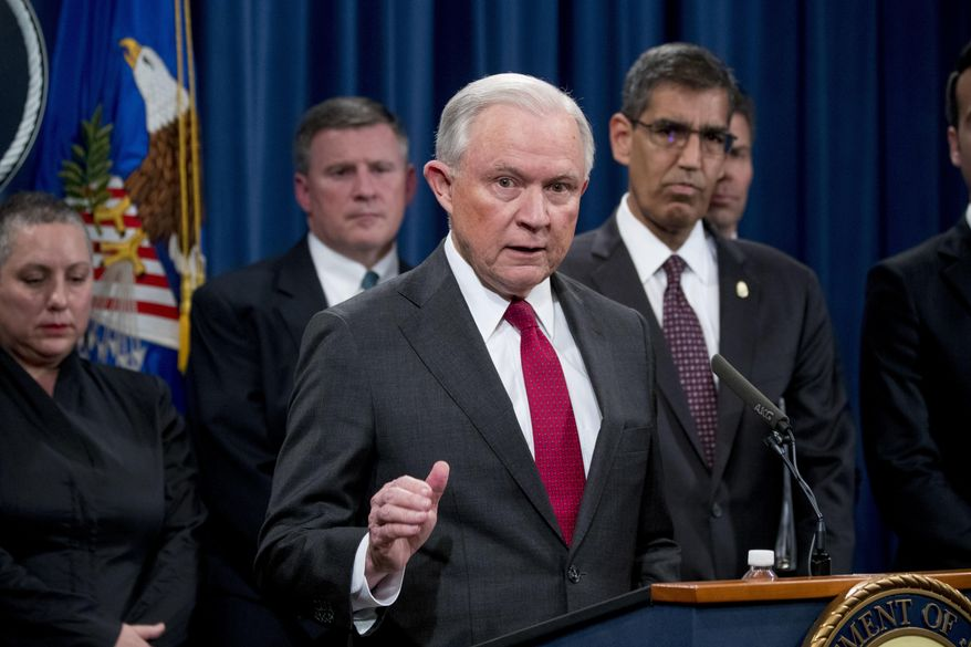 Attorney General Jeff Sessions accompanied by accompanied by Drug Enforcement Administration (DEA) Acting Administrator Uttam Dhillon, right, and other officials from the Drug Enforcement Administration, State Department, Treasury Department, Internal Revenue Service and Immigration and Customs Enforcement, speaks at a news conference to announce enforcement efforts against Cartel Jalisco Nueva Generacion, Tuesday, Oct. 16, 2018, at the Justice Department in Washington. (AP Photo/Andrew Harnik) ** FILE **