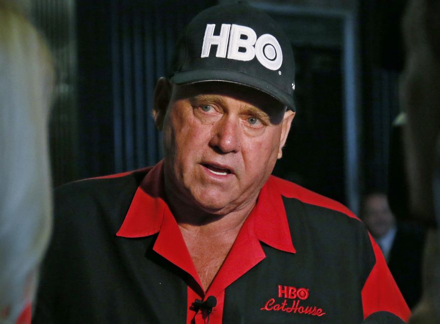 In this June 13, 2016, file photo, Dennis Hof, owner of the Moonlite BunnyRanch, a legal brothel near Carson City, Nev., is pictured during an interview during a break in the trial of Denny Edward Phillips and Russell Lee Hogshooter in Oklahoma City. Nevada authorities said Tuesday, Oct. 16, 2018, that Hof, a legal pimp who has fashioned himself as a Donald Trump-style Republican candidate has died. (AP Photo/Sue Ogrocki, File)