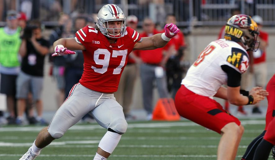 FILE - In this Oct. 7, 2017, file photo, Ohio State defensive end Nick Bosa rushes in against Maryland during an NCAA college football game Saturday, in Columbus, Ohio. Bosa's college football career is over. The injured All-American defensive end intends to withdraw from Ohio State to spend time rehabilitating and training for an NFL career. He is expected to be a first-round draft pick. No. 2 Ohio State made the announcement on Tuesday, Oct. 16, 2018. (AP Photo/Jay LaPrete) ** FILE **