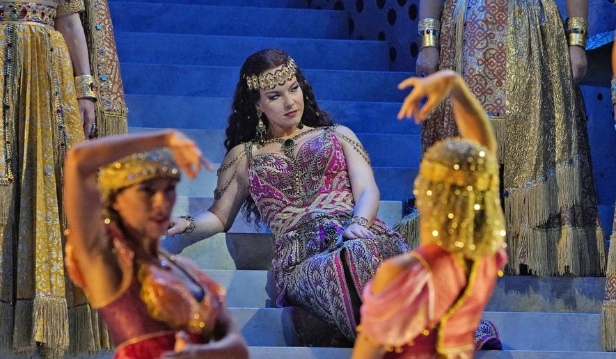 """This Sept. 11, 2018 photo released by The Metropolitan Opera shows mezzo-soprano Elina Garanca as Dalila in a scene from  Saint-Saens' """"Samson et Dalila"""" at the Metropolitan Opera in New York. A new production will be broadcast live in HD to movie theaters on Saturday, Oct. 20. (Ken Howard/Metropolitan Opera via AP)"""