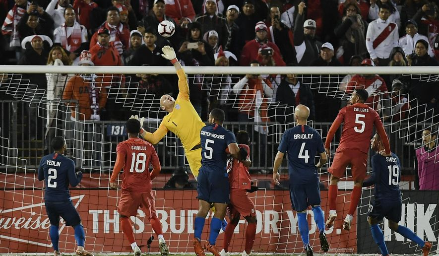 United States goalkeeper Brad Guzan (1) makes a save in the final minutes of an international friendly soccer match against Peru in East Hartford, Conn., Tuesday, Oct. 16, 2018. (AP Photo/Jessica Hill)
