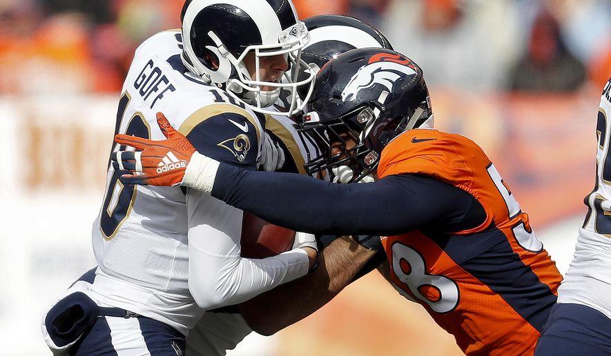 Denver Broncos linebacker Von Miller (58) sacks Los Angeles Rams quarterback Jared Goff (16) during the first half of an NFL football game, Sunday, Oct. 14, 2018, in Denver. (AP Photo/David Zalubowski)