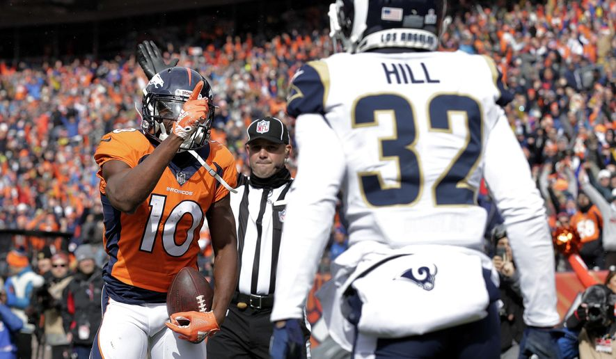 Denver Broncos wide receiver Emmanuel Sanders (10) taunts Los Angeles Rams cornerback Troy Hill (32) for a penalty during the first half of an NFL football game, Sunday, Oct. 14, 2018, in Denver. (AP Photo/Joe Mahoney)