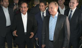 Russian President Vladimir Putin, foreground right, and Egyptian President Abdel-Fattah el-Sisi, foreground left, talk with local people during their meeting on embankment of the Olympic Park in the Black Sea resort of Sochi, Russia, Tuesday, Oct. 16, 2018. Egypt's president urged Russia on Tuesday to resume direct flights to Egyptian resorts as he discussed ways to bolster ties with Russian officials and lawmakers. (Alexei Druzhinin, Sputnik, Kremlin Pool Photo via AP)