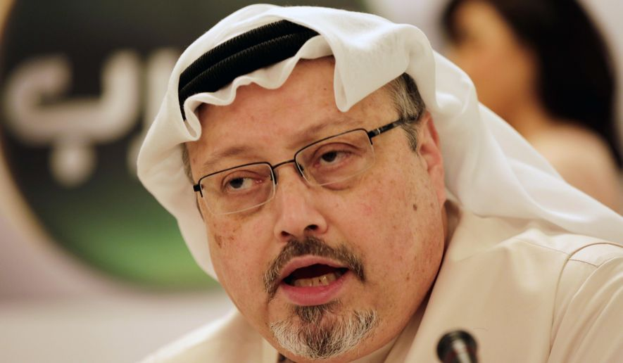 FILE - In this Dec. 15, 2014, file photo, Jamal Khashoggi, general manager of a new Arabic news channel, speaks during a news conference in Manama, Bahrain. Saudi Arabia is paying influential lobbyists, lawyers and public relations experts nearly $6 million a year to engage U.S. officials and promote the Middle East nation, even after several firms cut ties with the kingdom following the disappearance of journalist Khashoggi. (AP Photo/Hasan Jamali, File)