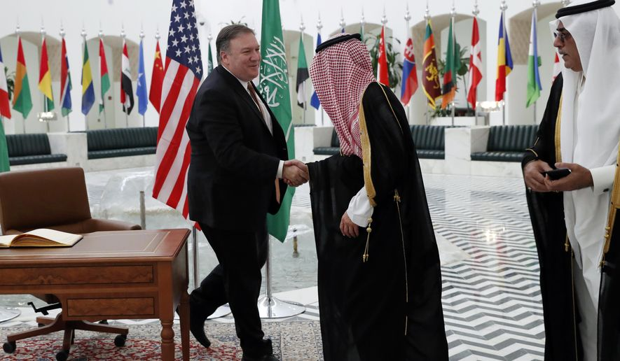 U.S. Secretary of State Mike Pompeo, left, shakes hands with Saudi Foreign Minister Adel al-Jubeir in Riyadh, Saudi Arabia, Tuesday Oct. 16, 2018. U.S. Secretary of State Mike Pompeo met on Tuesday with Saudi Arabia's King Salman over the disappearance and alleged slaying of Saudi writer Jamal Khashoggi, who vanished two weeks ago during a visit to the Saudi Consulate in Istanbul. (Leah Millis/Pool via AP)