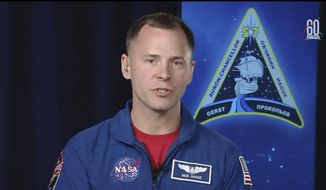 In this frame from video from NASA TV, NASA astronaut Nick Hague, who survived the Oct. 11, 2018, failed launch and emergency landing, speaks Tuesday, Oct. 16, 2018, from the NASA Johnson Space Center in Houston. Hague and Russian Alexei Ovchinin were two minutes into their flight last Thursday from Kazakhstan to the International Space Station when the Soyuz rocket failed. (NASA TV via AP)