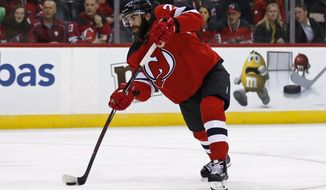 New Jersey Devils' Kyle Palmieri takes a shot against the Dallas Stars in the second period of an NHL hockey game Tuesday, Oct. 16, 2018, in Newark, NJ. (AP Photo/Adam Hunger)