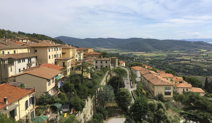 This Sept. 10, 2018 photo shows a view from the top of medieval hill town Cortona, in the province of Arezzo in the Tuscany region of Italy. (Anne D'Innocenzio via AP)