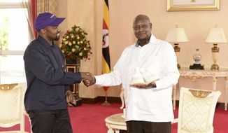 "In this photo taken Monday, Oct. 15, 2018, released by Presidential Press Unit, Kanye West, left, meets with Uganda's President Yoweri Museveni at State House in Entebbe, Uganda. Museveni said he and West held ""fruitful discussions"" about promoting tourism and arts in the East African nation in which the rapper is said to be recording music in a tent. (Presidential Press Unit via AP)"