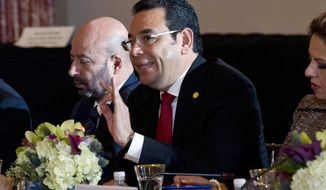 Guatemala's President Jimmy Morales speaks during the second Conference for Prosperity and Security in Central America at State Department on Thursday, Oct. 11, 2018, in Washington. (AP Photo/Jose Luis Magana)