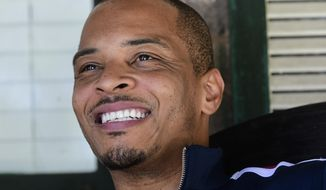 In this Sept. 14, 2018, file photo shows rapper Clifford Harris Jr., better known as T.I., on the porch of his grandparents' home where he grew up in Atlanta. (AP Photo/John Amis, File)
