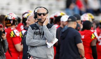 FILE - In this Saturday, Oct. 13, 2018, file photo Maryland interim head coach Matt Canada walks on the sideline during the second half of an NCAA college football game against Rutgers in College Park, Md. The Terrapins (4-2, 2-1) will be going for a second win over a ranked opponent when they visit the No. 19 Iowa Hawkeyes (5-1, 2-1) on Saturday. (AP Photo/Patrick Semansky, File) **FILE**