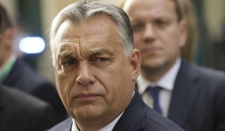 Hungarian Prime Minister Viktor Orban arrives for a meeting of the European People's Party EPP in Brussels, Belgium, Wednesday, Oct. 17, 2018 when European leaders meet to negotiate on terms of Britain's divorce from the European Union. (AP Photo/Olivier Matthys)