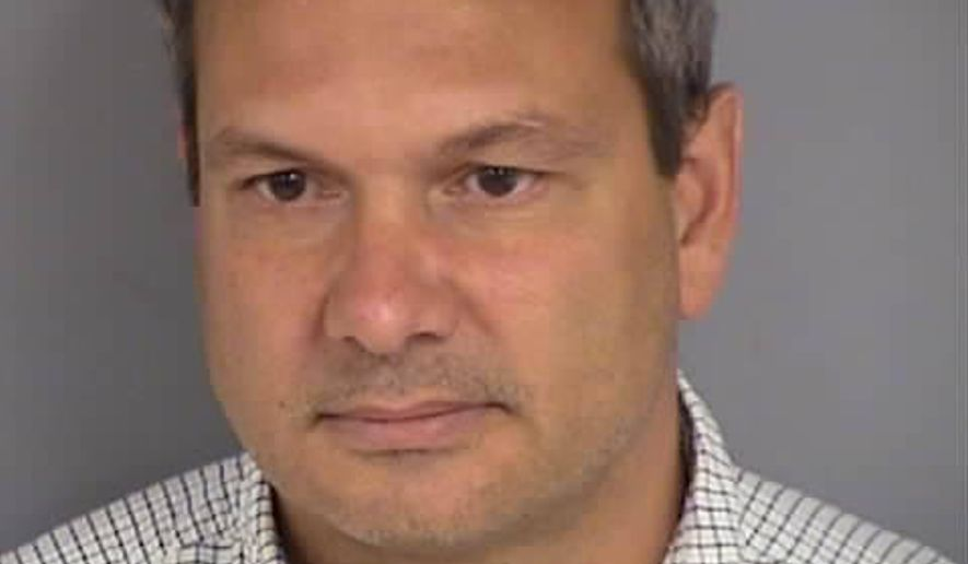 This undated photo provided by the las Vegas Department of Public Safety shows Wilfred Michael Stark, 50, of Falls Church, Va. Authorities say Stark was arrested Tuesday, Oct. 16, 2018, on a misdemeanor battery charge after he was accused of pushing into a Republican party event and grabbing the manager of Nevada state Attorney General Adam Laxalts gubernatorial campaign. (Las Vegas Department of Public Safety via AP)