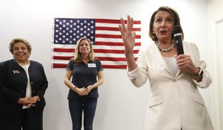 House Minority Leader Nancy Pelosi, right, speaks to volunteers at a get out the vote event for Florida Democratic congressional candidates Donna Shalala, left, and Debbie Mucarsel-Powell, center, Wednesday, Oct. 17, 2018, in Coral Gables, Fla. (AP Photo/Wilfredo Lee)