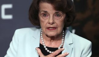 California Sen. Dianne Feinstein, D-Calif., gestures while speaking to California Sen. Kevin de Leon, D-Los Angeles, during a debate on Wednesday, Oct. 17, 2018, in San Francisco. Feinstein shared the stage with an opponent for the first time since 2000 when she debated state Sen. Kevin de Leon.The two Democrats are facing off in the Nov. 6 election. (AP Photo/Ben Margot)