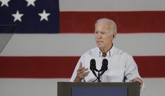 Former Vice President Joe Biden speaks during a rally for Democratic Sen. Joe Donnelly, Friday, Oct. 12, 2018, in Hammond, Ind. (AP Photo/Darron Cummings) ** FILE **