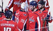 Washington Capitals defenseman Matt Niskanen (2) celebrates with Washington Capitals goaltender Braden Holtby (70) and others after an NHL hockey game, Wednesday, Oct. 17, 2018, in Washington. Niskanen scored the game-winning goal in overtime. The Capitals won 4-3 in overtime. (AP Photo/Nick Wass)