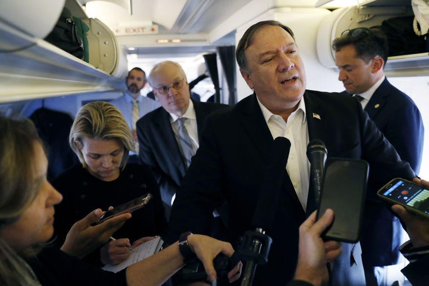 Secretary of State Mike Pompeo speaks to reporters while his plane refuels in Brussels, Belgium Wednesday, Oct. 17, 2018. (Leah Millis/Pool Image via AP)