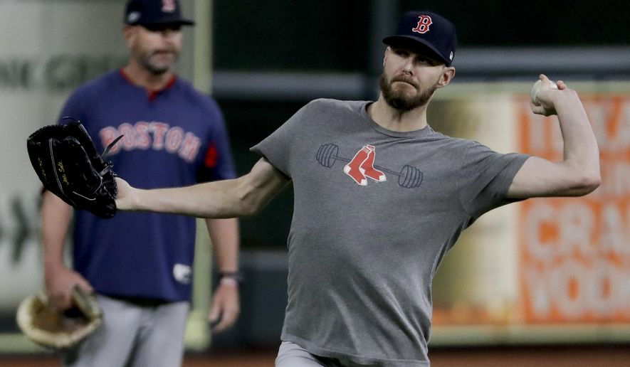 Boston Red Sox starting pitcher Chris Sale warms up during batting practice before Game 4 of a baseball American League Championship Series against the Houston Astros on Wednesday, Oct. 17, 2018, in Houston. (AP Photo/Frank Franklin II)