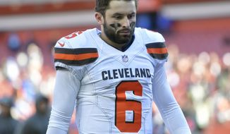 """FILE - In this Oct. 14, 2018, file photo, Cleveland Browns quarterback Baker Mayfield (6) walks off the field after a 38-14 loss to the Los Angeles Chargers in an NFL football game  in Cleveland. Physically, he's OK. Mentally, Cleveland's rookie quarterback is still hurting. """"That is the worst loss that I have ever had,"""" Mayfield said Wednesday, Oct. 17.(AP Photo/David Richard, File)"""