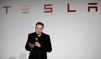 FILE - In this Sept. 29, 2015, file photo, Elon Musk, CEO of Tesla Motors Inc., talks about the Model X car at the company's headquarters, in Fremont, Calif. Electric auto brand Tesla Inc. says it has secured land in Shanghai for its first factory outside the United States, pushing ahead despite mounting U.S.-Chinese trade tensions. The company said it signed an agreement on a 210-acre (84-hectare) site. (AP Photo/Marcio Jose Sanchez, File)