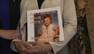 Carolyn Fortney, a survivor of sexual abuse at the hands of her family's Roman Catholic parish priest as a child, awaits legislation in the Pennsylvania Capitol to respond to a landmark state grand jury report on child sexual abuse in the Catholic Church, Wednesday, Oct. 17, 2018, in Harrisburg, Pa. (AP Photo/Marc Levy)