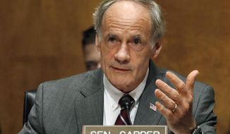 FILE - In this Tuesday, May 15, 2018, file photo, U.S. Sen. Thomas Carper, D-Del., asks a question of Homeland Security Secretary Kirstjen Nielsen as she testifies to the Senate Homeland Security Committee on Capitol Hill in Washington. Democratic U.S. Sen. Tom Carper is criticizing Republican attempts to dredge up a decades-old incident in which he slapped his ex-wife, leaving her with a black eye. During a debate Wednesday, Oct. 17, 2018 Republican challenger Rob Arlett brought up the incident, noting that October is Domestic Violence Awareness Month. (AP Photo/Jacquelyn Martin, File)