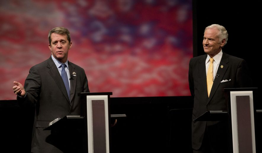 Democratic state Rep. James Smith and Republican Gov. Henry McMaster meet in the South Carolina governor debate, Wednesday, Oct. 17, 2018 at Francis Marion University Performing Arts Center in Florence, S.C. (Andrew J. Whitaker/The Post And Courier via AP)