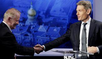 Republican candidate Leonard Lance, left, shakes hands with Democratic candidate Tom Malinowski prior to a U.S. Congressional District 7 debate, Wednesday, Oct. 17, 2018, in Newark, N.J. (AP Photo/Julio Cortez)